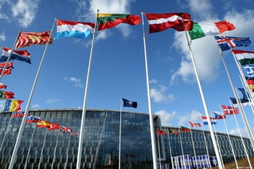 Flags of members of North Atlantic Treaty Organization (NATO) wave outside of the NATO Headquarters in Brussels, Belgium on 14 March 2019 [Dursun Aydemir/Anadolu Agency]