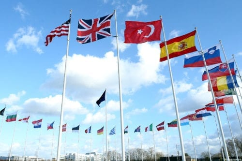 Flags of members of North Atlantic Treaty Organization (NATO) wave outside of the NATO Headquarters in Brussels, Belgium on 14 March 2019. [Dursun Aydemir - Anadolu Agency]