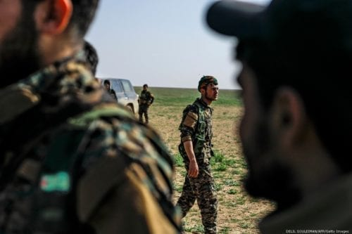 Fighters with the Syrian Democratic Forces (SDF) in Syria on 25 February 2019 [DELIL SOULEIMAN/AFP/Getty Images]