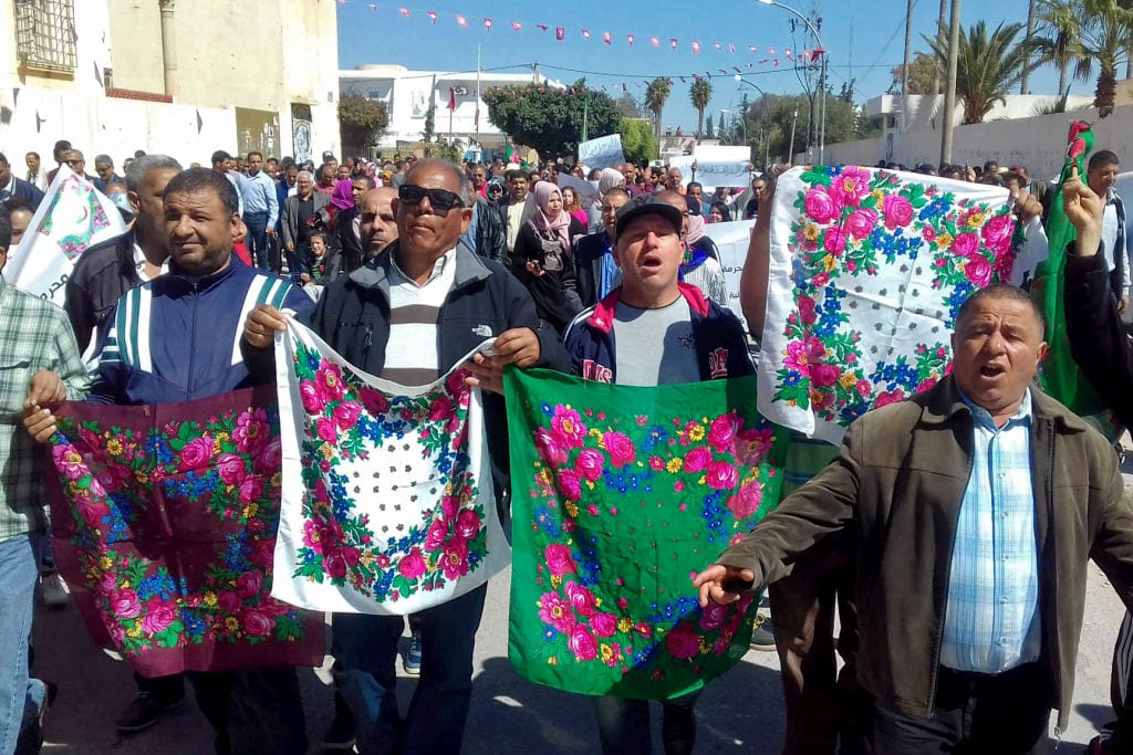 Tunisian protesters demonstrate in Sidi Bouzid on 29 April, 2019, after a car crash killed twelve people [MOKTAR MAHOULI/AFP/Getty Images]