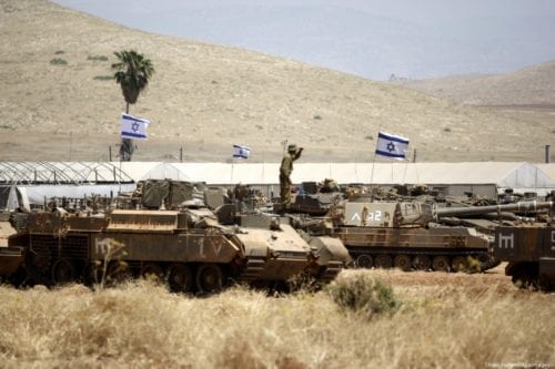 Israeli military's tanks seen stationed in the Jordan Valley during a military training exercise, on 6 May 2015 [Shadi Hatem/Apaimages