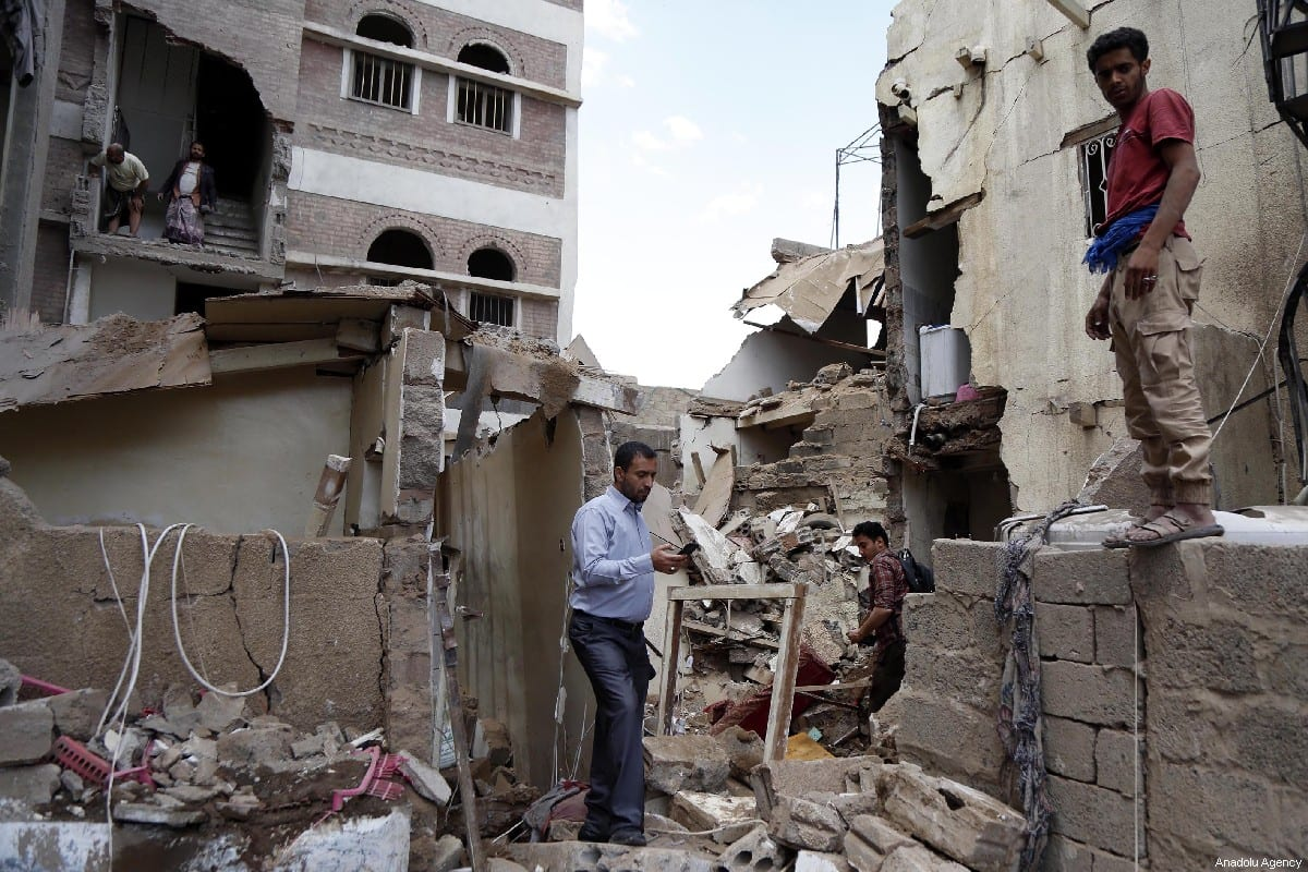 Damaged buildings are seen after the Saudi-led military coalition carried out air strikes in Sanaa, Yemen on 16 May 2019 [Mohammed Hamoud/Anadolu Agency]