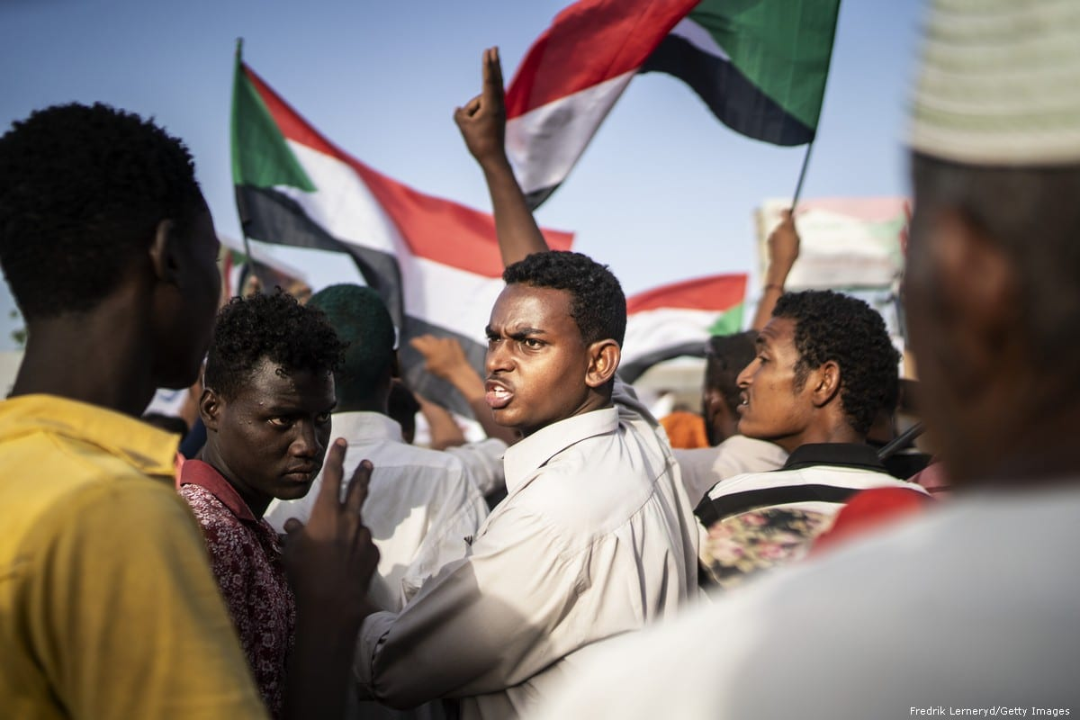 Sudanese demonstrators attend the ongoing protests demanding a civilian transition government in front of military headquarters in Khartoum, Sudan on 27 April 2019 [Mahmoud Hjaj/Anadolu Agency]