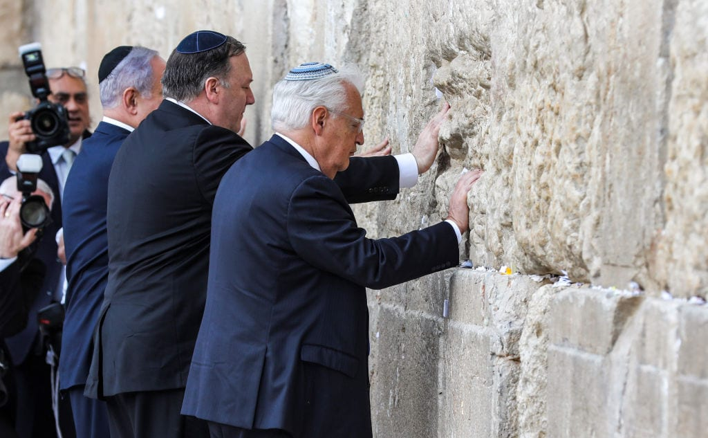 (L to R) Israeli Prime Minister Benjamin Netanyahu, US Secretary of State Mike Pompeo, and US ambassador to Israel David Friedman, touch the stones of the Western Wall in Jerusalem's Old City on 21 March, 2019, during the second day of Pompeo's visit as part of his five-day regional tour of the Middle East [ABIR SULTAN/AFP/Getty Images]