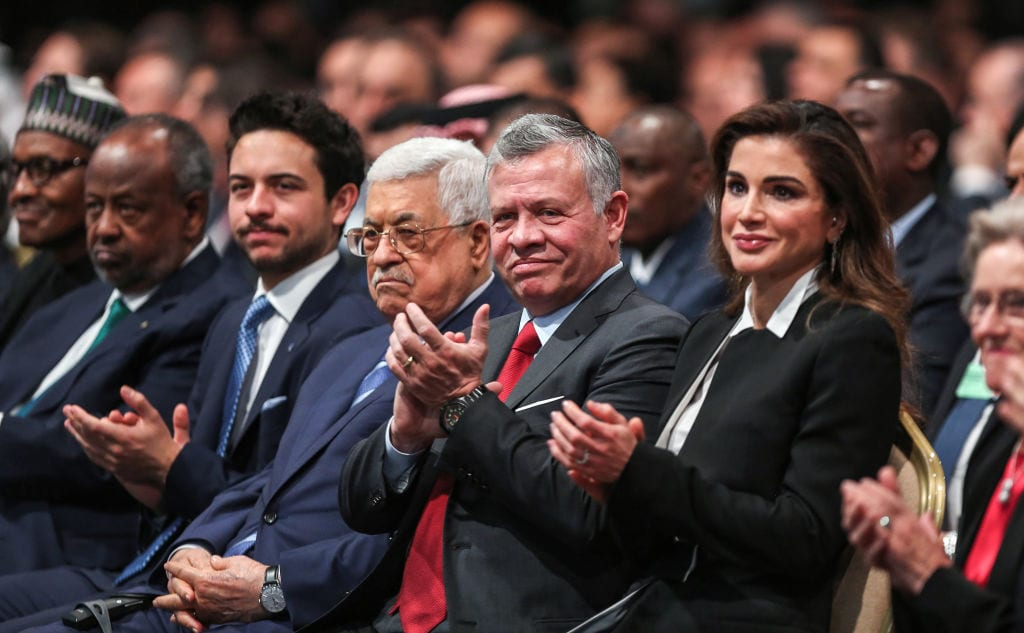 (R to L) Queen Rania of Jordan, King Abdullah II of Jordan, Palestinian president Mahmoud Abbas, and Jordan's Crown Prince Hussein applaud as they attend the opening ceremony of the 2019 World Economic Forum on the Middle East and North Africa, at the King Hussein Convention Centre at the Dead Sea, in Jordan on 6 April, 2019 [KHALIL MAZRAAWI/AFP/Getty Images]