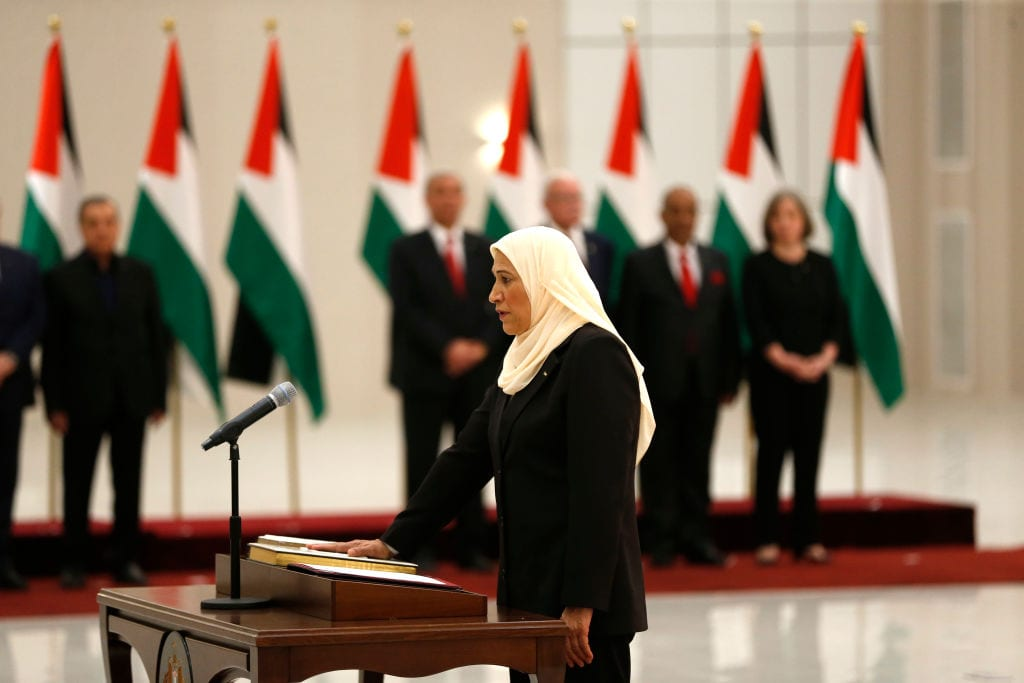 Amal Hamad is sworn in as a Minister of Women's Affairs in the new Palestinian government, in the Israeli-occupied West Bank town of Ramallah, on April 13, 2019. [ABBAS MOMANI/AFP/Getty Images]