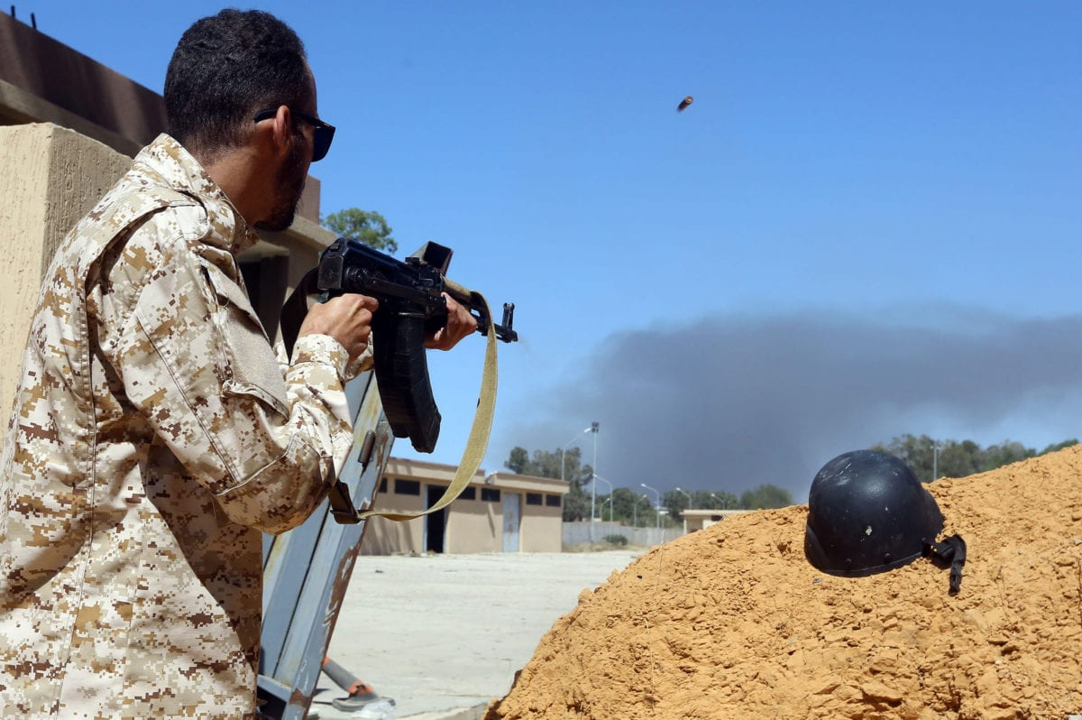 A fighter loyal to the internationally recognised Libyan Government of National Accord (GNA) keeps position near the Salah al-Din military compound, south of the Libyan capital Tripoli, on 7 May 2019 [Mahmud TURKIA/AFP/Getty]