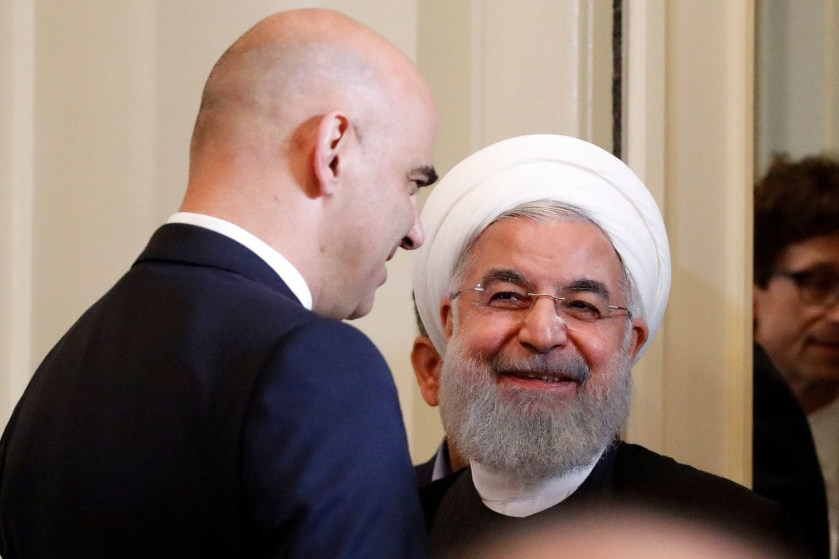 Iranian President Hassan Rouhani (R) and Swiss President Alain Berset share a light moment at a joint press conference following various signing ceremonies in Bern on 3 July 2018. [RUBEN SPRICH / AFP / Getty]