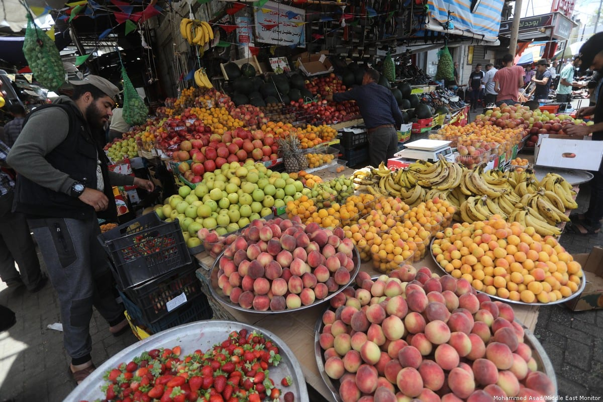 Palestinians can be seen in the marketplace in Gaza on 3 June 2019 [Mohammed Asad/Middle East Monitor]