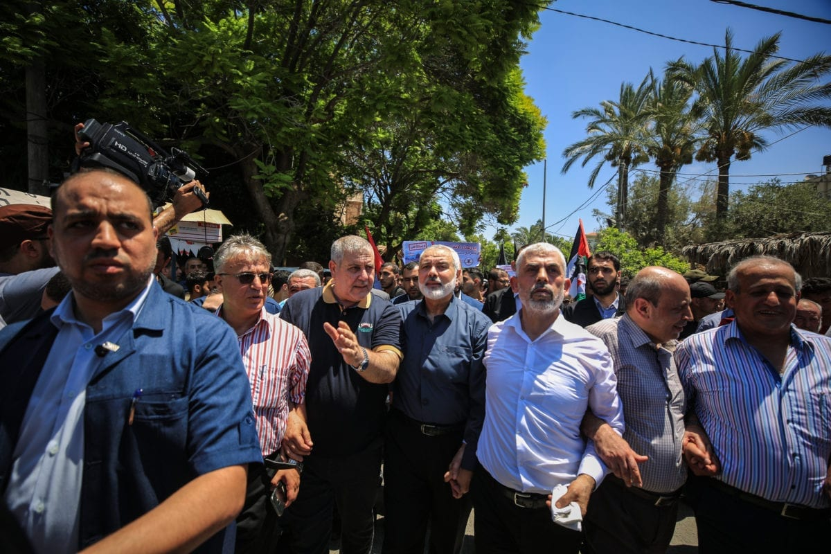 Head of the Political Bureau of Hamas Ismail Haniyeh (4th R) and Leader of Hamas in the Gaza Strip, Yahya Sinwar (3rd R) attend a demonstration against the U.S.-led conference in Bahrain, on 26 June, 2019 in Gaza City, Gaz [Ali Jadallah/Anadolu Agency]