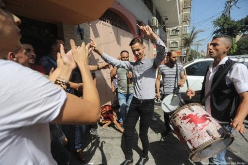 Palestinians celebrate with food after they received their school exams results on 18 July 2019 [Mohammed Asad/Middle East Monitor]