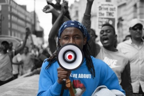 Protesters in London march on the 30th anniversary of when Ousted Sudan President, Omar Al-Bashir came into power through the coup [Hamduni Said]