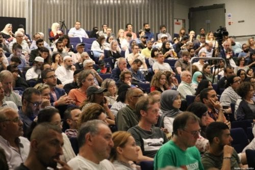 The audience seen in the main lecture theatre during the first day of the Palestine Expo 2019 on 6 July 2019 in London, UK [Middle East Monitor]