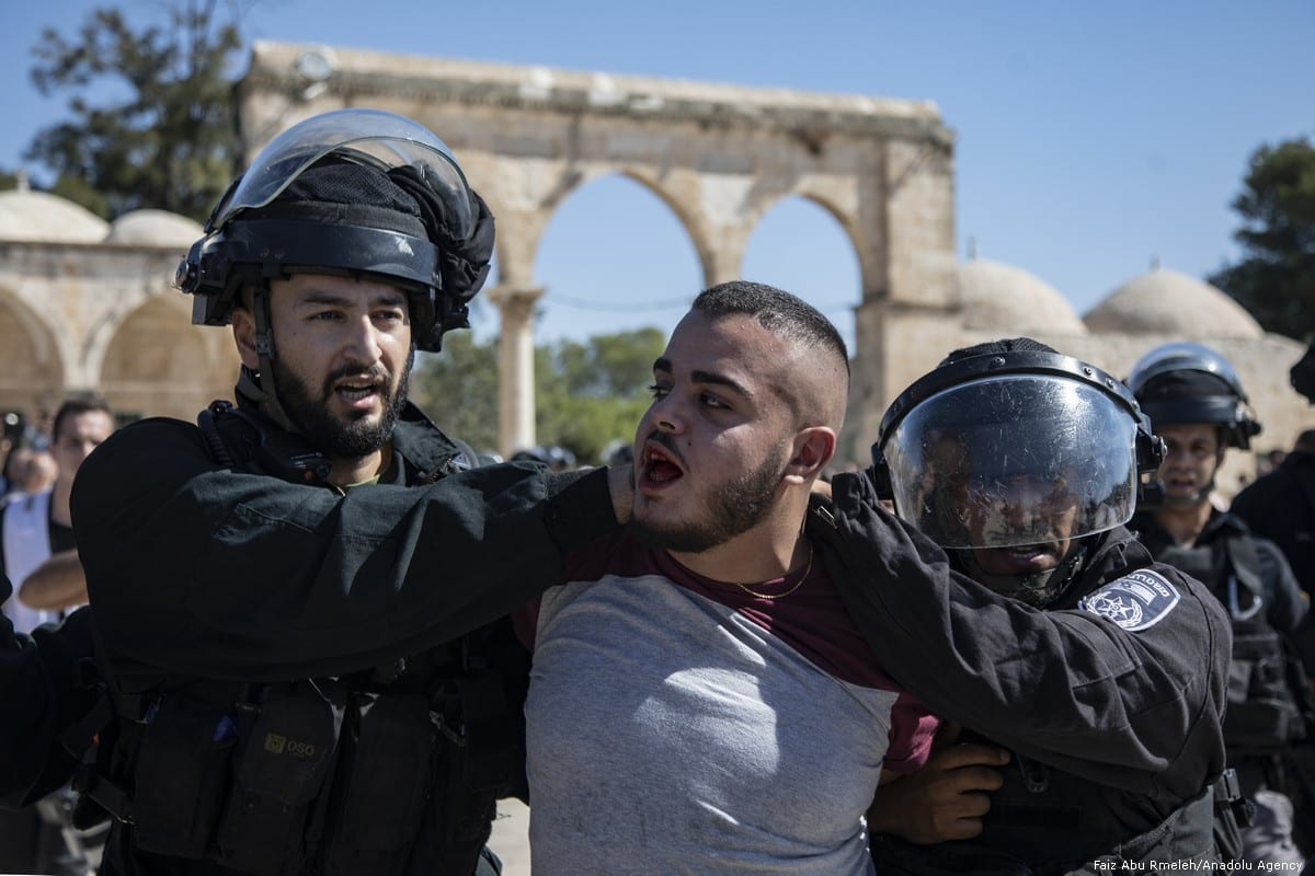 Israeli forces attack Palestinian worshippers in Jerusalem's Al-Aqsa mosque on 11 August 2019 [Faiz Abu Rmeleh/Anadolu Agency]
