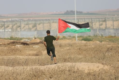 Palestinians converged near a security fence that separates Gaza Strip from Israel to demonstrate against Israel's decades-long occupation of Palestinian territories on 2 August 2019 [Mohammed Asad/Middle East Monitor]