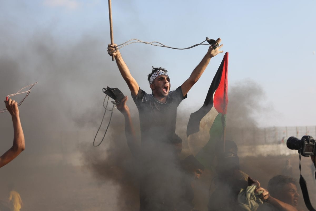 Palestinian youths were injured after Israeli forces fired tear gas on protesters during the Great March of Return in Gaza on Friday 13 September, 2019 [Mohammed Asad/Middle East Monitor]
