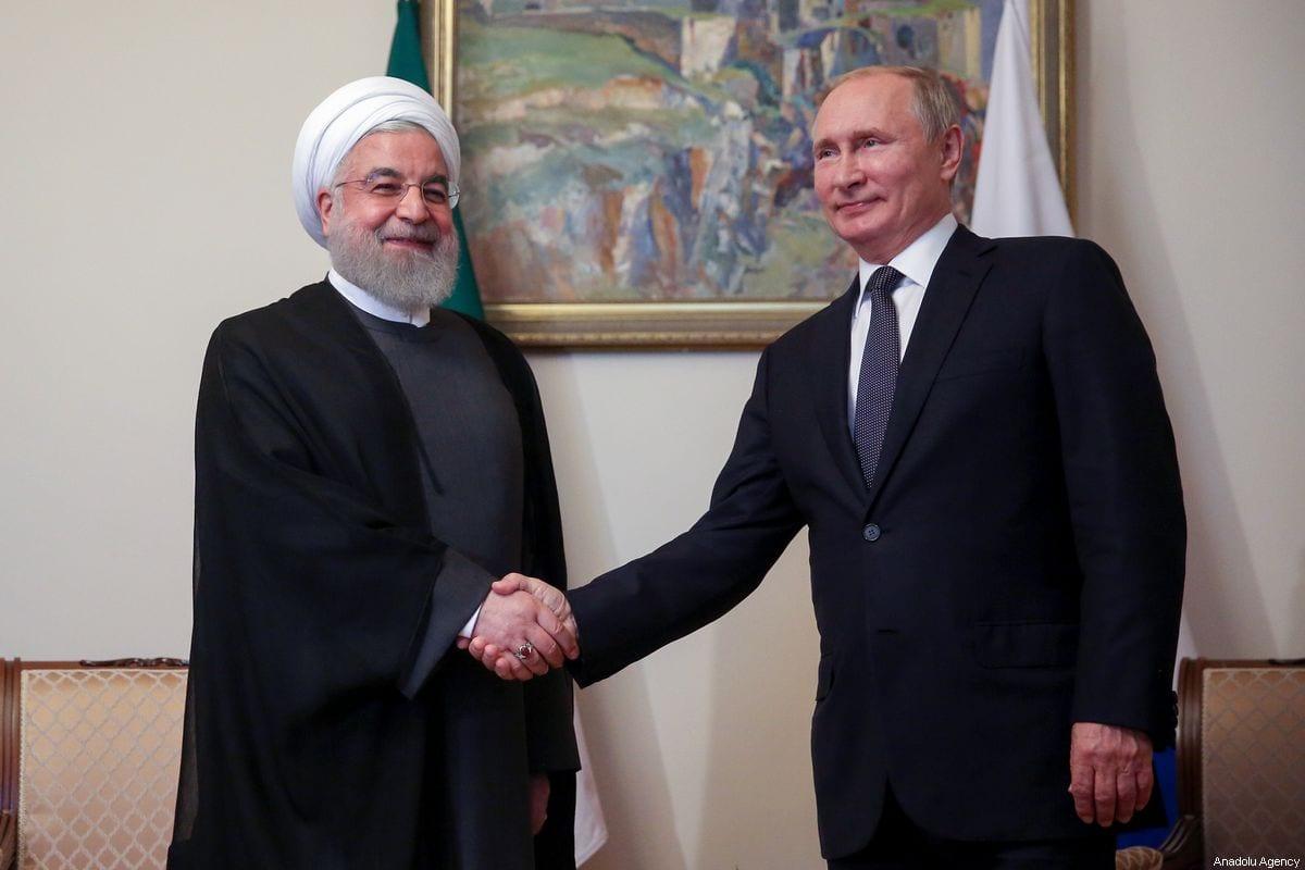Iranian President Hassan Rouhani (L) shakes hands with Russian President Vladimir Putin in Yerevan, Iran on 1 October 2019 [Iranian Presidency/Anadolu Agency]