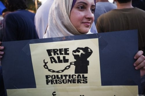 A woman demonstrates with hundreds on 1 July, 2012 in front of the presidential palace in Cairo to demand the realease of political prisoners [GIANLUIGI GUERCIA/AFP/GettyImages]