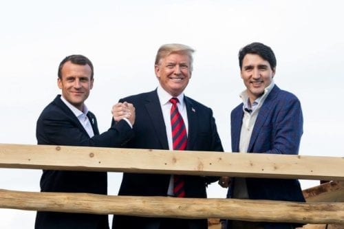 President Donald J. Trump stands with French President Emmanuel Macron and Canadian Prime Minister Justin Trudeau as they arrived for a G7 Working Dinner in La Malbaie, Quebec on 9 June 2018 [Wikipedia]