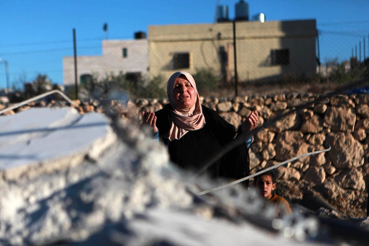 A Palestinian woman cries at debris of a building after Israeli forces demolished houses of 4 Palestinians, accused of killing an Israeli soldier, at Beit Kahil village in Hebron, West Bank on 28 November 2019. [Mamoun Wazwaz - Anadolu Agency]
