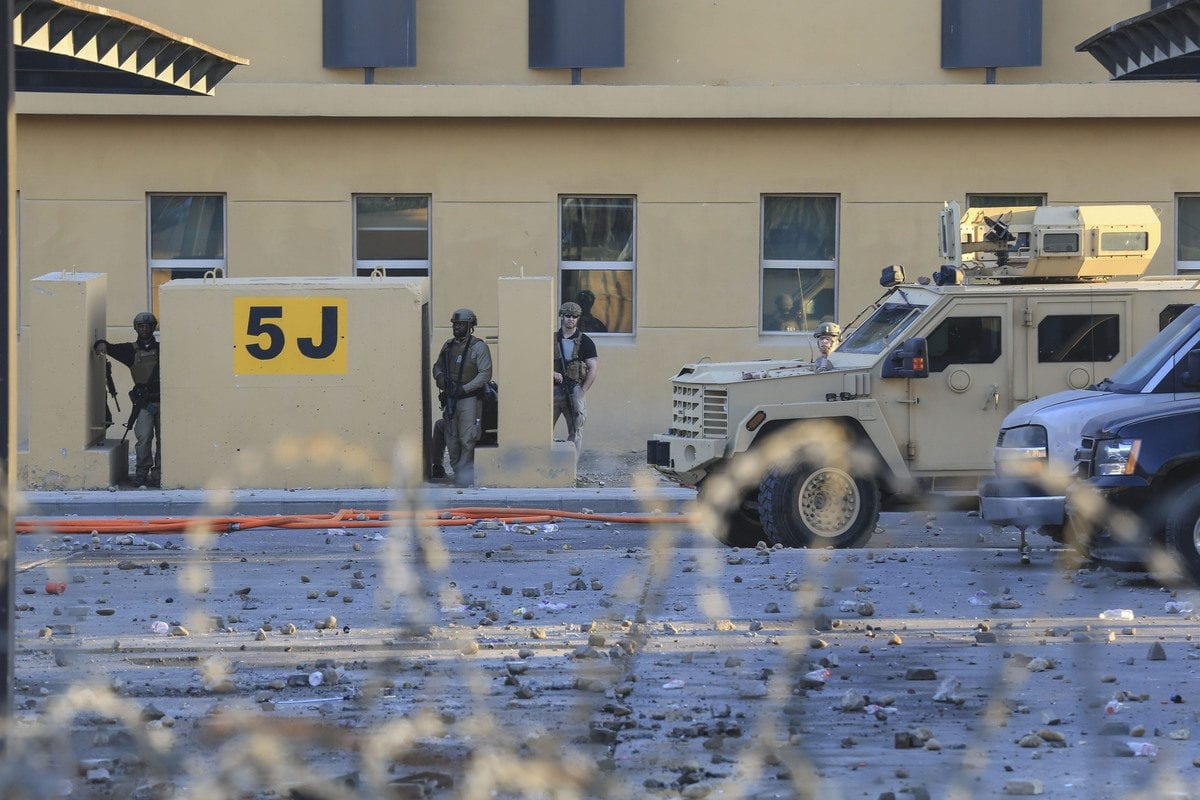 US soldiers stand guard as outraged Iraqi protesters storm the US Embassy in Baghdad, protesting Washington's attacks on armed battalions belong to Iranian-backed Hashd al-Shaabi forces on 31 December 2019. [Murtadha Sudani - Anadolu Agency]