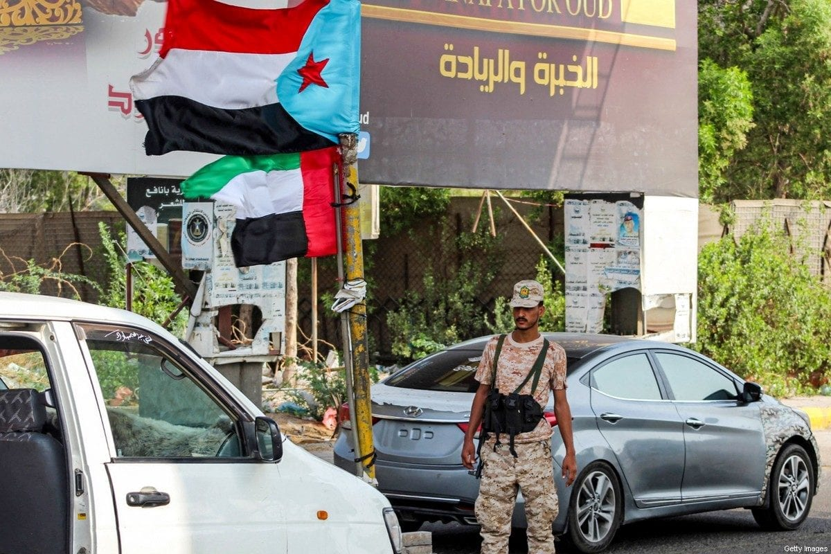 A UAE-backedSouthern Transitional Council(STC) soldier stops cars at a security checkpoint in Yemen on 4 September 2019 [SALEH AL-OBEIDI/AFP/Getty Images]