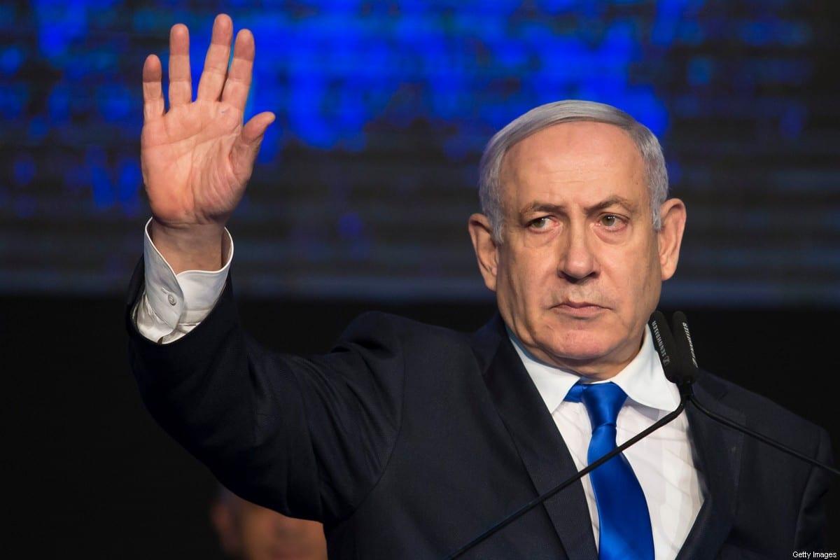 Israeli Prime Minister Benjamin Netanyahu gestuers supporters after speaking at a Likud Party gathering on 17 November 2019 in Tel Aviv, Israel. [Amir Levy/Getty Images]