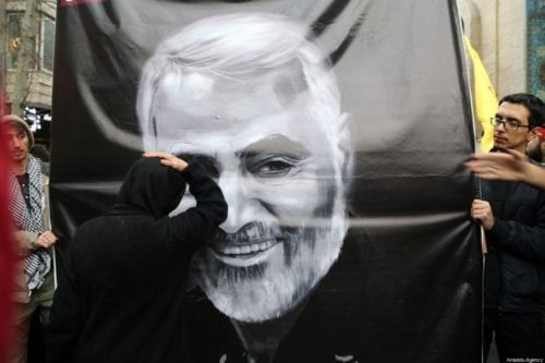Demonstrators carry an image of Iranian Revolutionary Guards' Quds Force commander Qasem Soleimani, who was killed by a US airstrike in the Iraqi capital Baghdad, during an anti-US rally to protest the killing at Palestine Square in the capital Tehran, Iran on January 4, 2020 [Fatemeh Bahrami / Anadolu Agency]