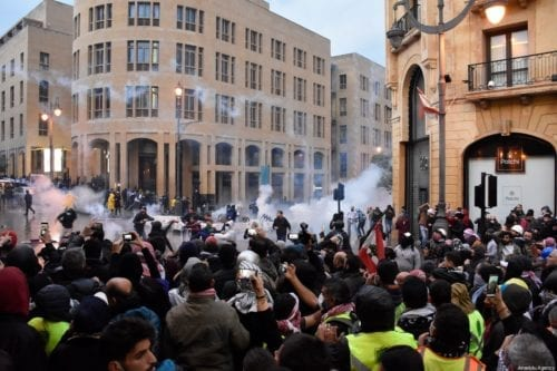 Security forces fire tear gas canisters as they clash with protestors during a protest against the country's economic and political situation in Beirut, Lebanon on January 18, 2020 [Mahmut Geldi / Anadolu Agency]