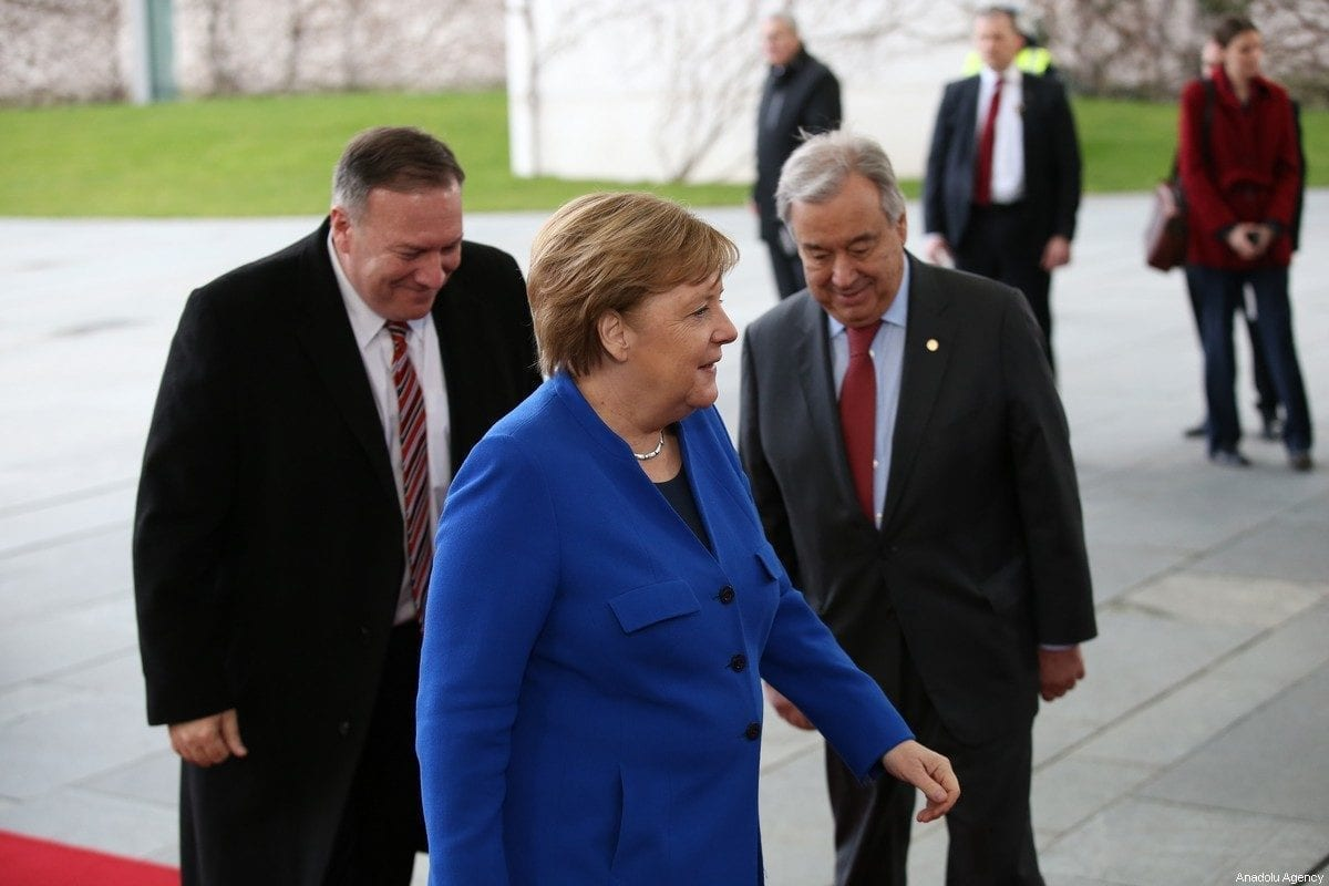 Secretary of State Mike Pompeo, German Chancellor Angela Merkel and United Nations Secretary-General, Antonio Guterres pose for a photo within the Berlin Conference on Libyan peace in Berlin, Germany on January 19, 2020. [Murat Kula/Anadolu Agency]