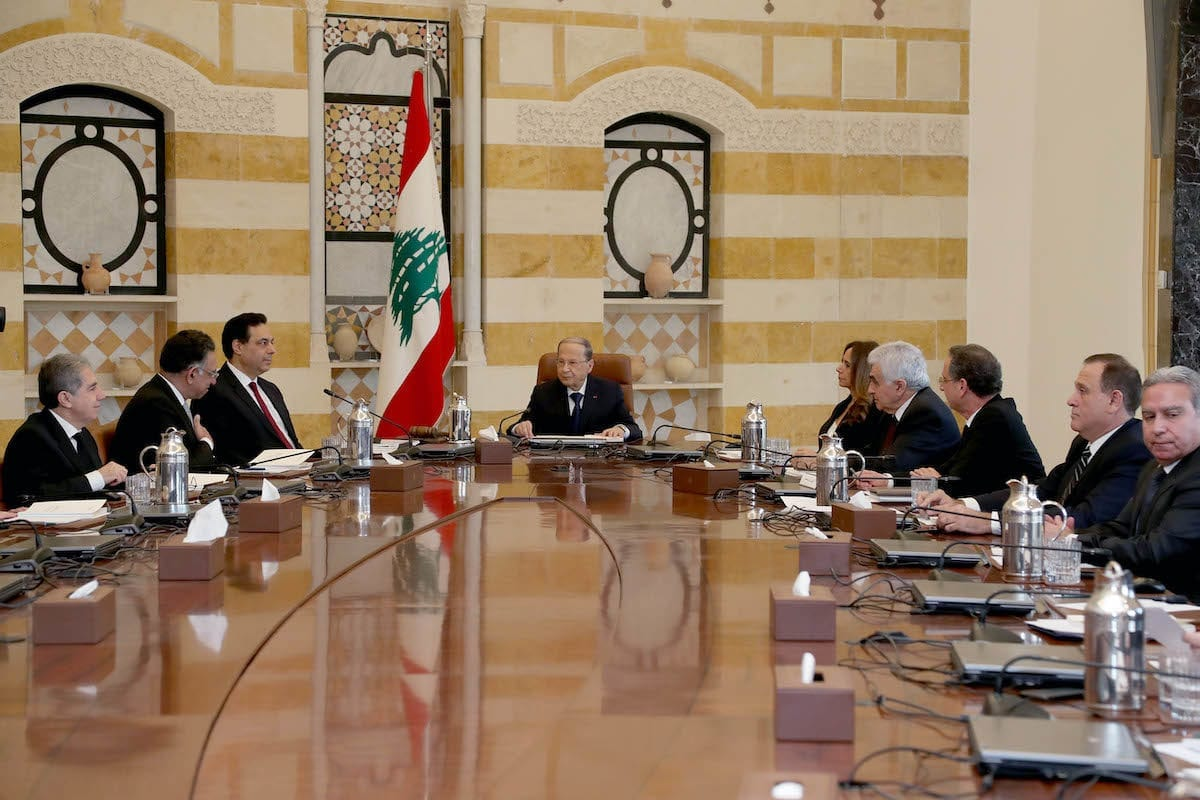 Lebanese President Michel Aoun (C) meets with Prime Minister-designate Hassan Diab (3rd L) and newly assigned cabinet members at Baabda Palace in Beirut, Lebanon on 22 January 2020. [LEBANESE PRESIDENCY / HANDOUT - Anadolu Agency]