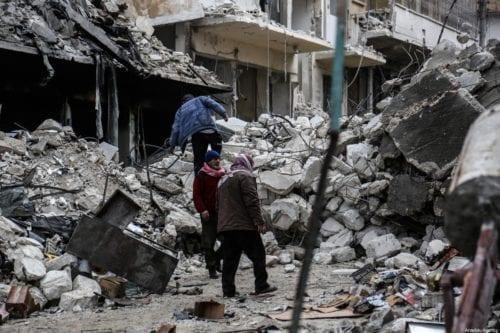 Collapsed and damaged buildings after Russian warplanes hit residential areas in Idlib, Syria on 30 January 2020 [İzzeddin İdilbi/Anadolu Agency]