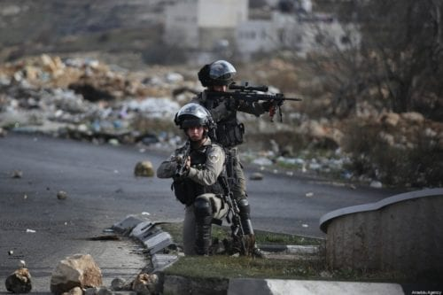 Israeli forces at a checkpoint in the West Bank on 30 January 2020 [Issam Rimawi/Anadolu Agency]