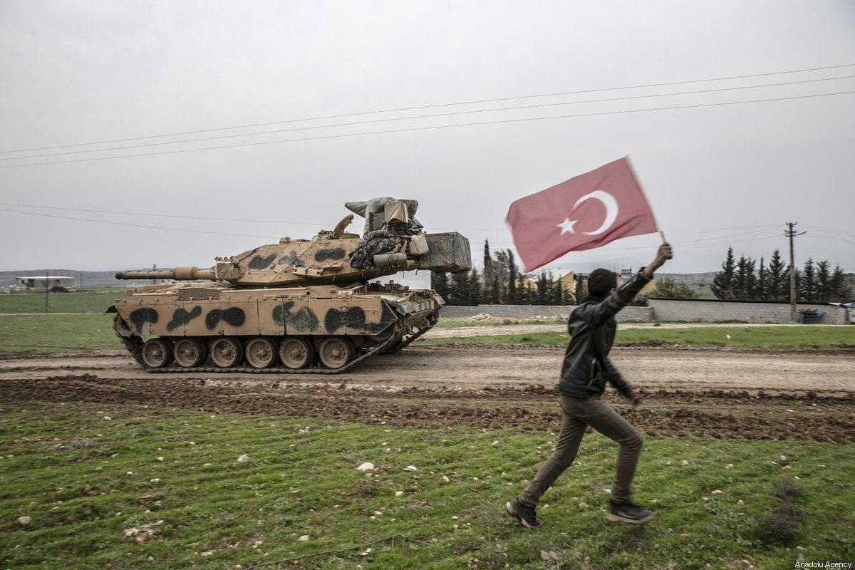 Turkish Armed Forces' tanks, self-propelled (storm) howitzers, hedgehogs, armored construction machine and military vehicles arrived at Reyhanli district and continue their deployment process to Syria border in Hatay, Turkey on February 14, 2020 [Cem Genco / Anadolu Agency]