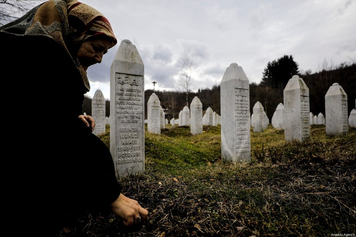 Mother of a Srebrenica victim Fazila Efendic visits graves of her husband and son who lost their lives in the genocide, which started on July 11, 1995 when soldiers under the command of Serbian commander Ratko Mladic took over the city of Srebrenica, at Potocari Memorial Cemetery in Srebrenica, Bosnia and Herzegovina on February 15, 2020. [Samır Jordamovıc - Anadolu Agency]