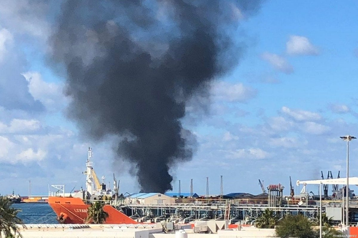 Smoke rises after warlord Khalifa Haftar's forces launched an attack on a port near the Martyrs' Square, where celebration events marking the 9th anniversary of February 17 revolution are held, in eastern Tripoli, Libya on February 18, 2020. [Aydoğan Kalabalık - Anadolu Agency]