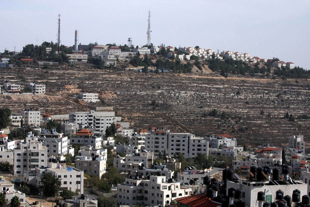 """A view of the illegal settlement known to Israelis as """"Pisagot"""" (background) and the Palestinian of Al-Bireh city is seen near the West Bank city of Ramallah on December 9,2010 [Issam Rimawi / ApaImages]"""