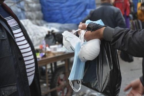 A seller sells medical masks at a bazaar as a precaution for coronavirus in Kirkuk, Iraq on 25 February 2020 [Ali Makram Ghareeb/Anadolu Agency]