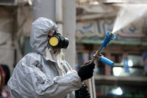 Civil defense team with protective suits disinfect the streets and workplaces as a precaution to the coronavirus (Covid-19) in Baghdad, Iraq on March 09, 2020 [Murtadha Al-Sudani - Anadolu Agency]