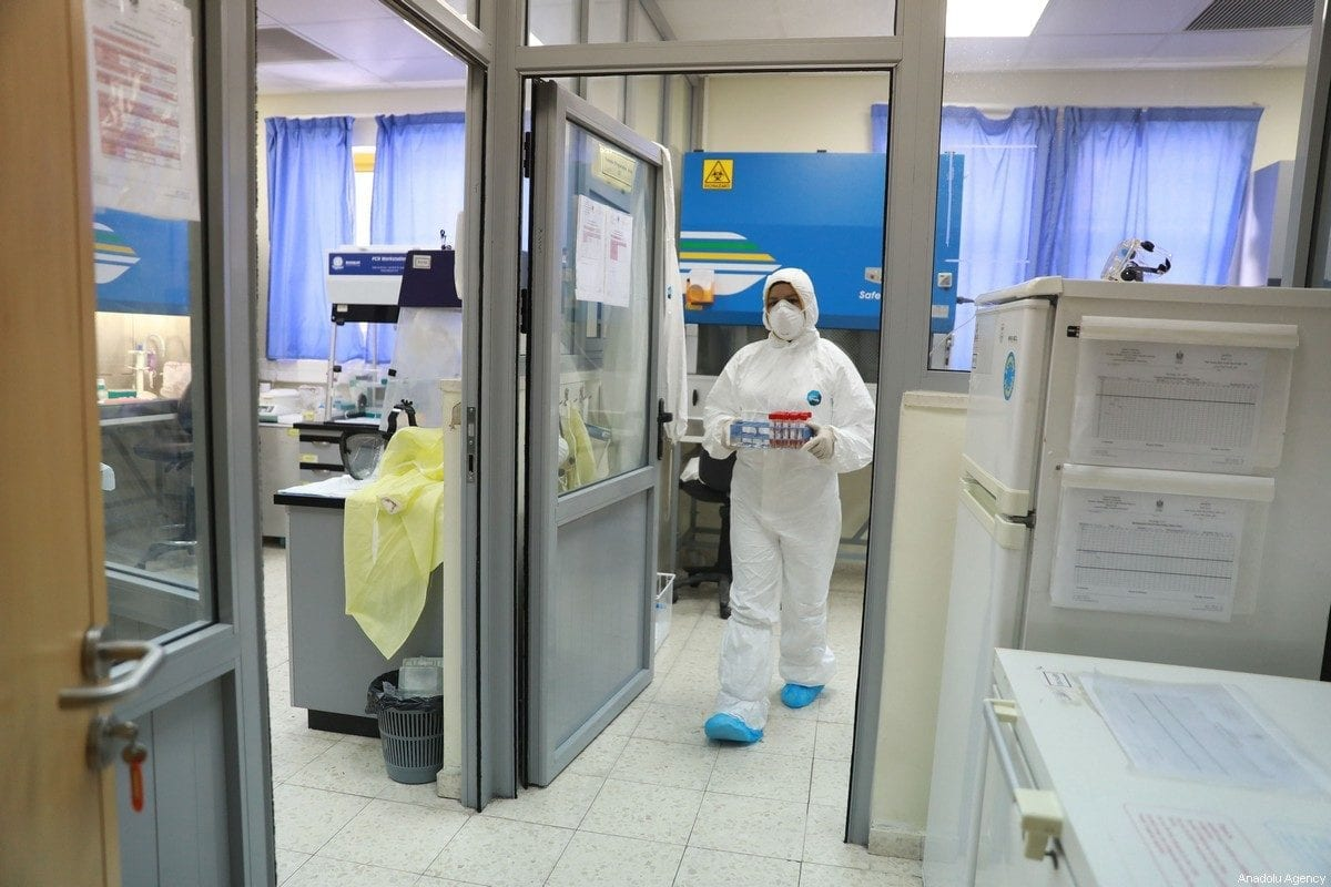 COVID-19 tests are being carried out at the Central Laboratory of the Palestinian Ministry of Health in the city of Ramallah, West Bank on March 16, 2020. The total number of coronavirus cases in West Bank climbed to 39. [Issam Rimawi - Anadolu Agency]