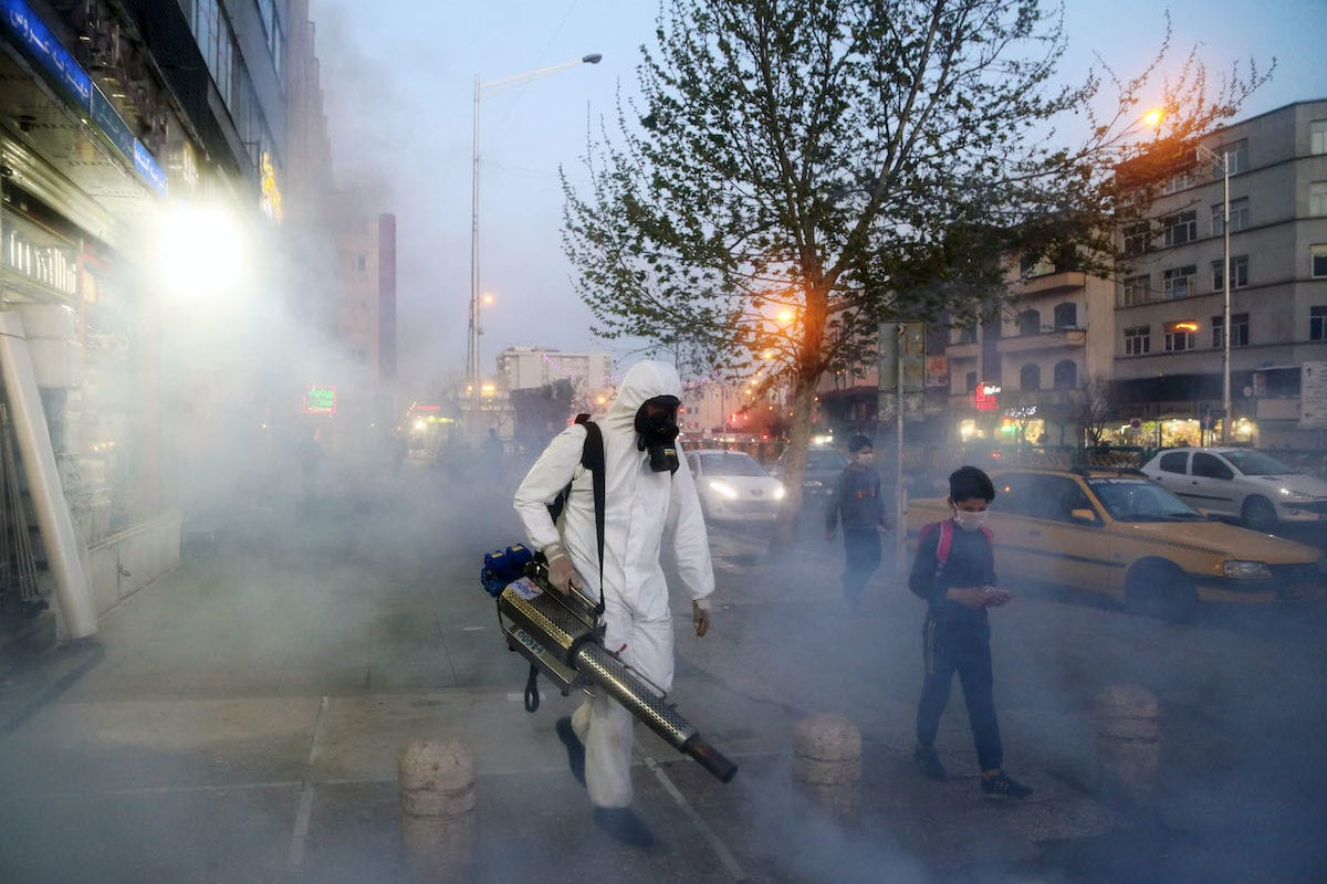 Fire brigade crews wearing protective masks carry out disinfection works due to the coronavirus (COVID-19) outbreak, on 19 March 2020 in Tehran, Iran. [Fatemeh Bahrami - Anadolu Agency]