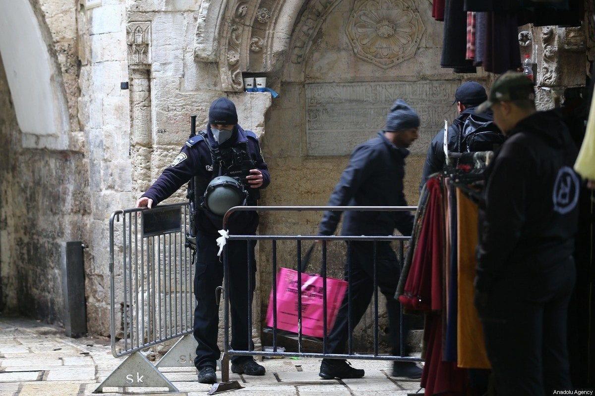 Israeli forces stand guard at checkpoints within the coronavirus (Covid-19) pandemic precautions ahead of the Friday Prayer in Jerusalem on 20 March, 2020 [Mostafa Alkharouf/Anadolu Agency]