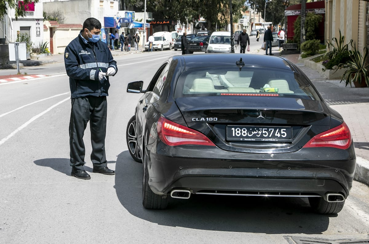 Tunisian security forces warn people as they take security measures after a partial curfew declaration on March 18, within precautions against coronavirus (COVID-19) in Bizerte region of Tunis, Tunisia on March 28, 2020 [Nacer Talel / Anadolu Agency]