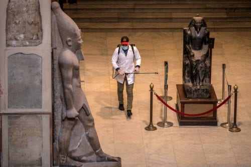 A worker disinfects the atrium of the Egyptian Museum in Cairo's landmark Tahrir Square amid the COVID-19 coronavirus pandemic, on 23 March 2020. [KHALED DESOUKI/AFP via Getty Images]