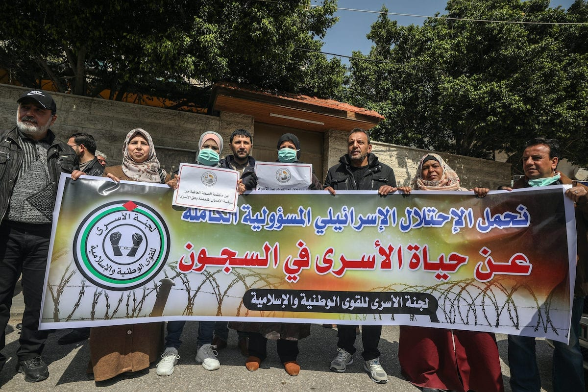 Palestinians gather for a demonstration to demand coronavirus (COVID-19) protection for Palestinian prisoners held in Israeli jails, in Gaza City, Gaza on 19 March 2020. [Ali Jadallah - Anadolu Agency]