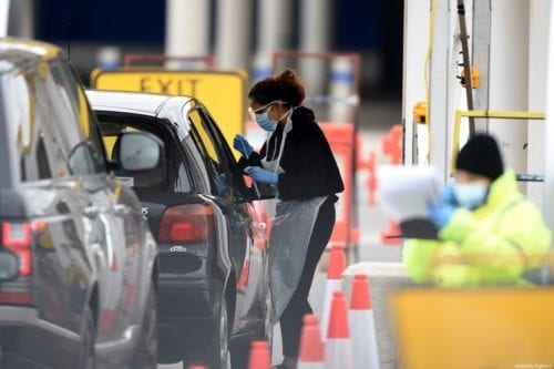 NHS workers check people at a coronavirus (COVID-19) drive-through testing station set up at the Wembley IKEA store for NHS staff on 1 April 2020 in London, UK [Kate Green/Anadolu Agency]