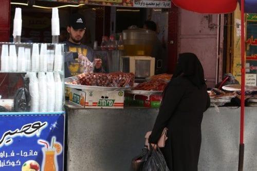 A Palestinian women at a bakery in Gaza on 20 April 2020 [Abed Rahim Khatib/Anadolu Agency]