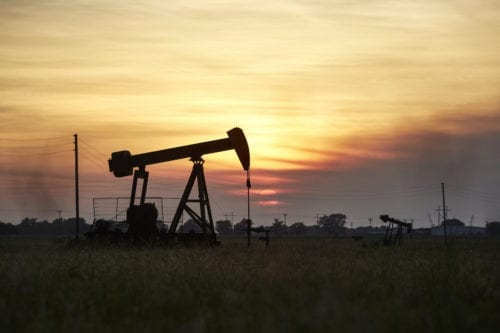 An oil derrick pumps crude from the ground near on April 20, 2020 [Dave Creaney/Anadolu Agency]