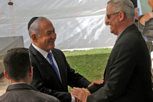 Israeli Prime Minister Benjamin Netanyahu (L) greets Benny Gantz, leader of Blue and White party, at a memorial ceremony for late Israeli president Shimon Peres, at Mount Herzl in Jerusalem on 19 September 2019. [GIL COHEN-MAGEN/AFP via Getty Images[