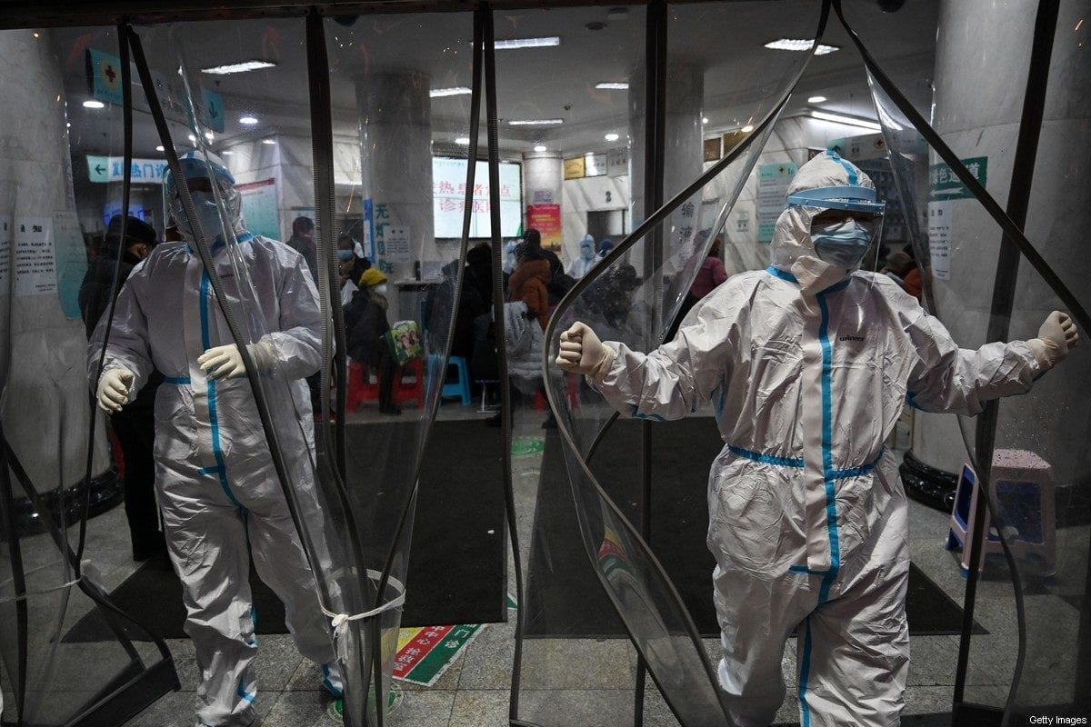 Medical staff members wearing protective clothing to help stop the spread of Covid-19 in Wuhan China on 25 January 2020[HECTOR RETAMAL/AFP/Getty Images]